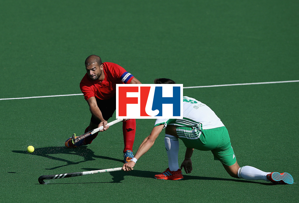JOHANNESBURG, SOUTH AFRICA - JULY 13: Ahmed Ezz of Egypt and Matthew Nelson of Ireland  battle for possession  during day 3 of the FIH Hockey World League Semi Finals Pool B match between Ireland and Egypt at Wits University on July 13, 2017 in Johannesburg, South Africa. (Photo by Jan Kruger/Getty Images for FIH)