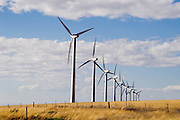 Modern wind turbines, photographed in central Oregon by Brian Smale. Wide open skies, and golden farmers' fields.