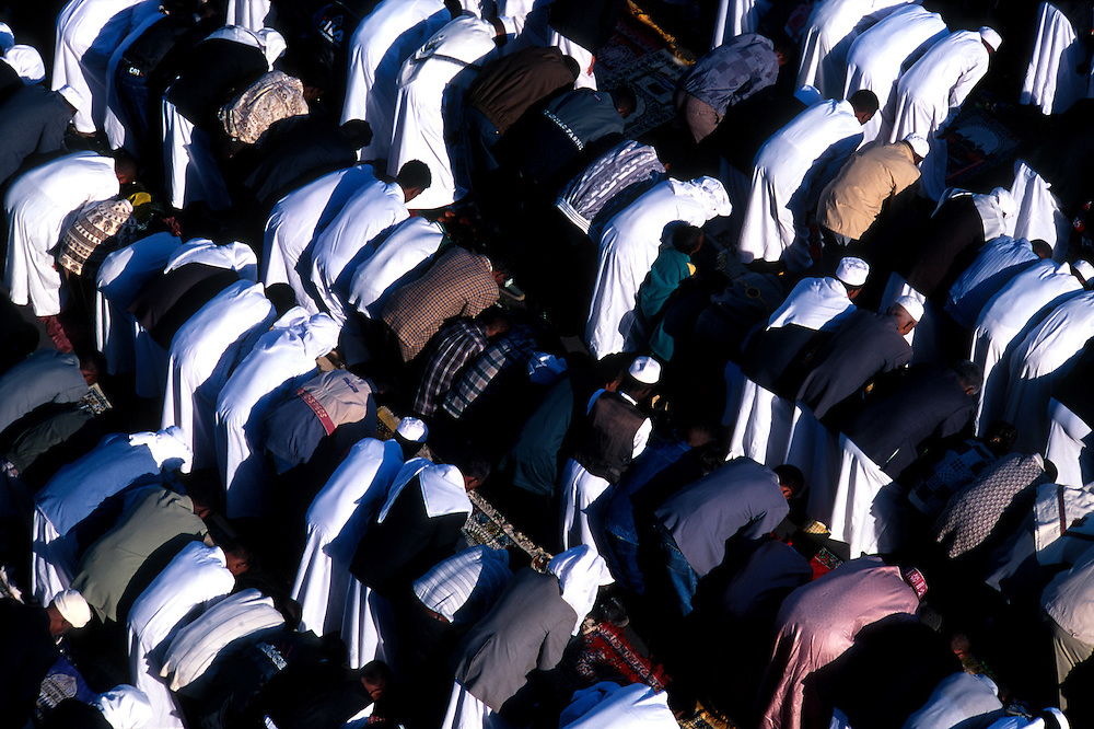 Muslims gather for prayers during the religious festival of Eid at the  Al Qurafi al Rashidin Mosque ('Followers of the Right Path') which was built in 1937 by Italian architects, Asmara, Eritrea.