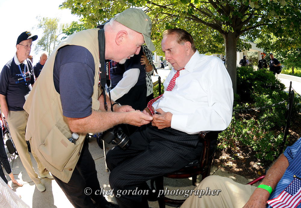 Former U.S. Senator Bob Dole (R-Kan, right) greets WWII Veterans and their escorts at the WWII Memorial in Washington, DC during their Hudson Valley Honor Flight on Saturday, September 27, 2014. Nearly one hundred WWII Veterans from the Hudson Valley region of New York toured the WWII Memorial in Washington, DC and Arlington National Cemetery in Arlington, VA.  © www.chetgordon.com