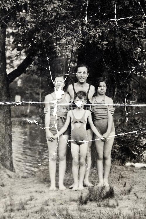 damaged vintage group portrait outdoors 1935