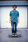Man on a skateboard in downtown Anchorage, Alaska. 2009