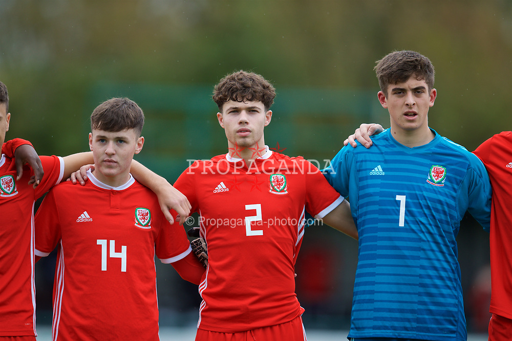 NEWPORT, WALES - Monday, October 14, 2019: Wales' (L-R) Harry Pinchard, Neco Williams and goalkeeper Lewis Webbline-up for the national anthem before an Under-19's International Friendly match between Wales and Austria at Dragon Park. (Pic by David Rawcliffe/Propaganda)