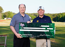 Peach Bowl, Inc. CEO & President Gary Stokan presents Notre Dame head football coach Brian Kelly a check for his charity after the Chick-fil-A Peach Bowl Challenge at the Ritz Carlton Reynolds, Lake Oconee, on Tuesday, April 30, 2019, in Greensboro, GA. (Paul Abell via Abell Images for Chick-fil-A Peach Bowl Challenge)