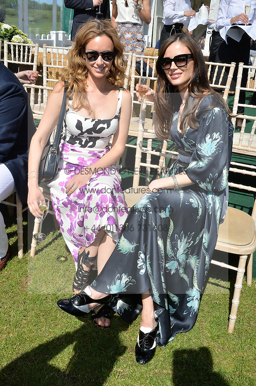 Left to right, CAMILLA AL FAYED and GEORGINA CHAPMAN at the St.Regis International Polo Cup at Cowdray Park, Midhurst, West Sussex on 16th May 2015.