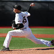 Dustin Hunt #45 of the Northeastern Huskies pitches during the game at Friedman Diamond on March 16, 2014 in Brookline, Massachusetts. (Photo by Elan Kawesch)