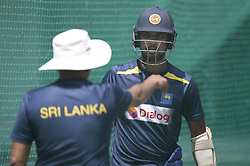 October 26, 2018 - Colombo, Sri Lanka - Sri Lanka cricket team's head coach Chandika Hathurusingha (L) instructs Sri Lankan ODI cricket captain Dinesh Chandimal during a net practice session ahead of the only Twenty-20 cricket match  between Sri Lankan and England at R Premadasa International Cricket ground, Colombo, Sri Lanka.10-26-2018  (Credit Image: © Tharaka Basnayaka/NurPhoto via ZUMA Press)