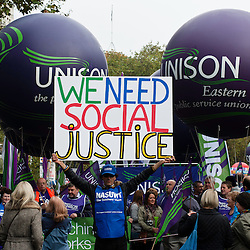 London, UK - 20 October 2012: A man holds a banner reading 'We need social justice' during the TUC-organised march 'A future that works' against austerity cuts in central London.