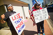 08 JUNE 2012 - PHOENIX, AZ: ANGEL GARCIA (left) and others picket the Arizona Democratic party headquarters. About 30 members of the Arizona Democratic Party picketed party headquarters Friday to show their unhappiness with party leadership. They claim the party, or party endorsed candidates, is accepting money from the American Legislative Exchange Council (ALEC) and is not properly supporting Democratic candidates not endorsed by the party, even during the primaries.         PHOTO BY JACK KURTZ