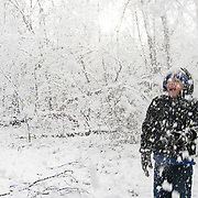 Hunter Bell of Columbia, S.C. enjoys the snow after shaking a tree limb. ©Travis Bell Photography