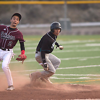 011113      Cayla Nimmo<br /> <br /> Shiprock Chieftain Julian Aspaas (15) is taken out at second base during he championship game against Magdelana Saturday evening at Ford Canyon Park.