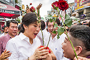 17 FEBRUARY 2013 - BANGKOK, THAILAND: Thai Prime Minister YINGLUCK SHINAWATRA campaigns for Pongsapat Pongchareon on Khao San Road in Bangkok Sunday. Pol General Pongsapat Pongcharoen, a former deputy national police chief who also served as secretary-general of the Narcotics Control Board is the Pheu Thai Party candidate in the upcoming Bangkok governor's election. (He resigned from the police force to run for Governor.) Former Prime Minister Thaksin Shinawatra reportedly recruited Pongsapat. Most of Thailand's reputable polls have reported that Pongsapat is leading in the race and likely to defeat Sukhumbhand Paribatra, the Thai Democrats' candidate and incumbent. The loss of Bangkok would be a serious blow to the Democrats, whose base is the Bangkok area.      PHOTO BY JACK KURTZ
