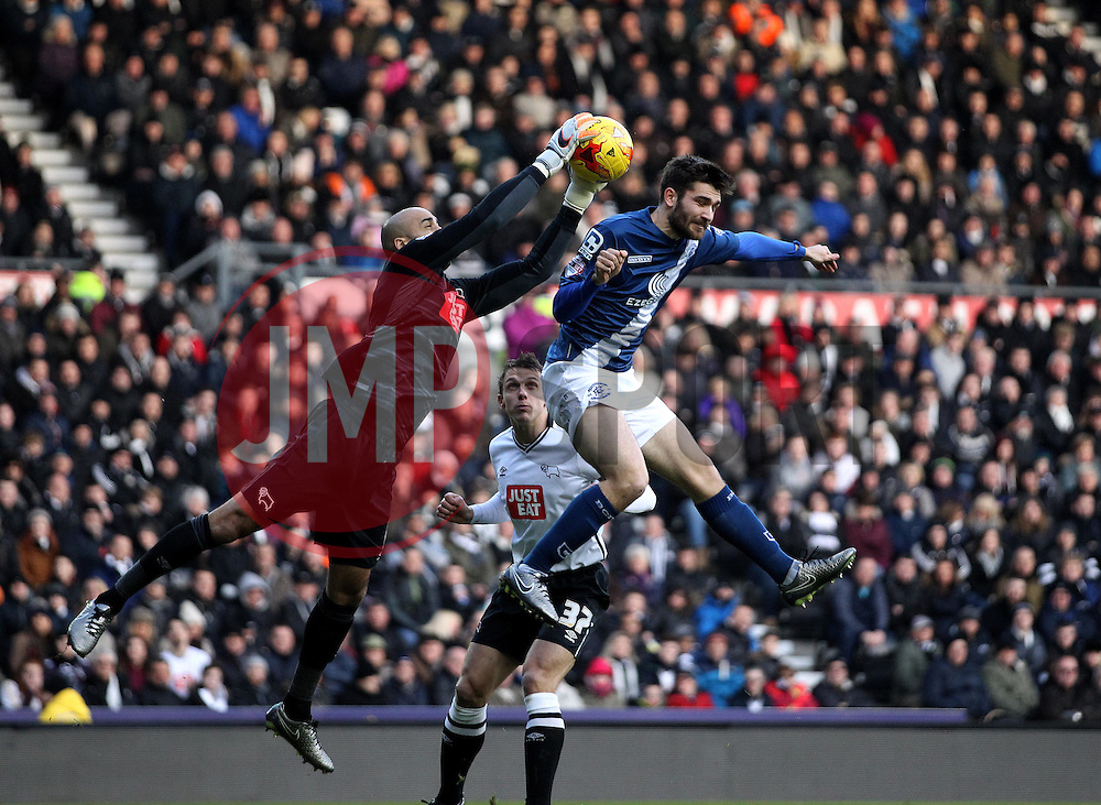 Lee Grant of Derby County punches clear from Jon Toral of Birmingham City - Mandatory byline: Robbie Stephenson/JMP - 16/01/2016 - FOOTBALL - iPro Stadium - Derby, England - Derby County v Birmingham City - Sky Bet Championship