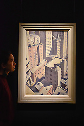 "© Licensed to London News Pictures. 17/11/2017. London, UK.  London, UK.  17 November 2017. A staff member views ""Looking down on Downtown"", 1920, by C.R.W. Nevinson (Est. GBP 100-150k).  Preview upcoming auctions of Modern & Post War British Art and Scottish Art taking place at Sotheby's, New Bond Street, on 21 and 22 November. Photo credit: Stephen Chung/LNP"