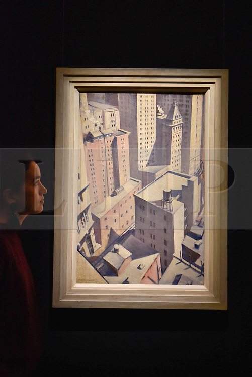 """© Licensed to London News Pictures. 17/11/2017. London, UK.  London, UK.  17 November 2017. A staff member views """"Looking down on Downtown"""", 1920, by C.R.W. Nevinson (Est. GBP 100-150k).  Preview upcoming auctions of Modern & Post War British Art and Scottish Art taking place at Sotheby's, New Bond Street, on 21 and 22 November. Photo credit: Stephen Chung/LNP"""
