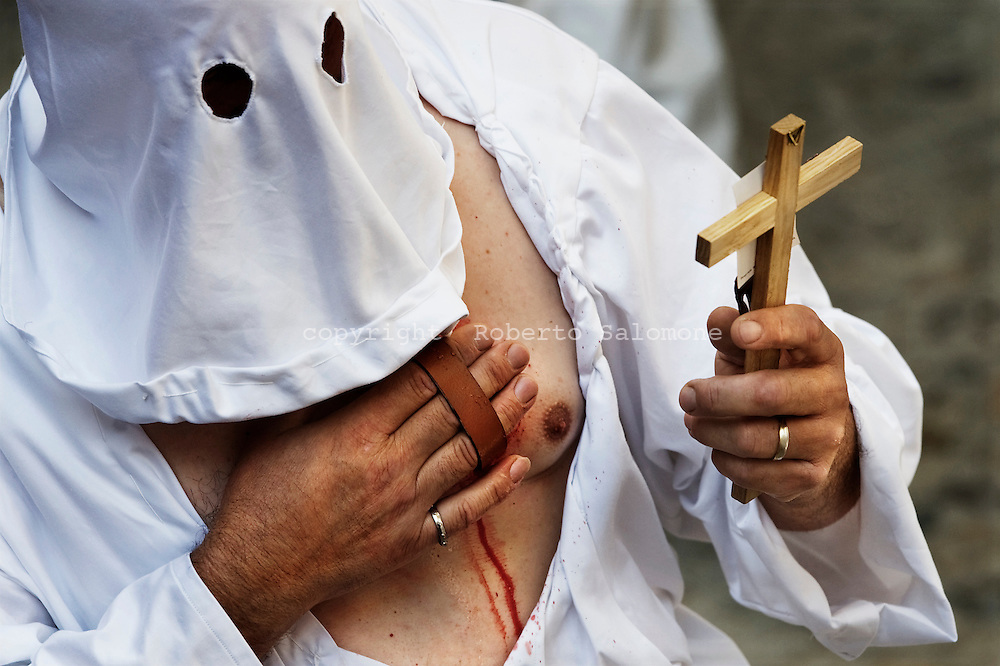 """Christian penitents known locally as """"Battenti"""" beat themselves during a procession in honour of the Virgin Mary in Guardia Sanframondi, near Benevento south of Italy. Around 1,000 penitents from across the world attended the procession which occurs once every seven years."""