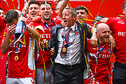 Lee Bowyer of Charlton Athletic (Manager) celebrates with his players after winning the play off trophy during the EFL Sky Bet League 1 play off final match between Charlton Athletic and Sunderland at Wembley Stadium, London, England on 26 May 2019.