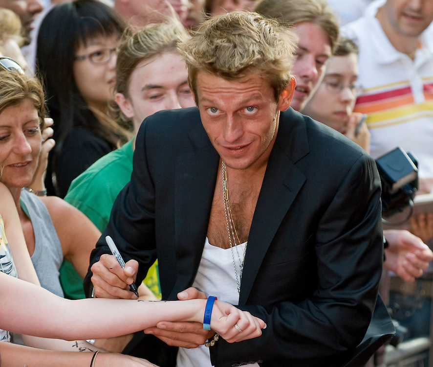 LONDON, July 28th Leo Gregory signing the arm of a fan at  Premiere of real life british drama CASS in Leiscester Square