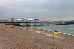 © Licensed to London News Pictures. 04/09/2014. Brighton, UK. Brighton Beach during lunch. Temperatures are expected to reach around the 14C in Brighton and the South Coast. Photo credit : Hugo Michiels/LNP