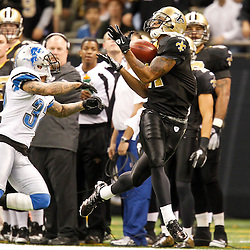 December 4, 2011; New Orleans, LA, USA; New Orleans Saints wide receiver Robert Meachem (17) catches a pass over Detroit Lions cornerback Aaron Berry (32) during a game at the Mercedes-Benz Superdome. The Saints defeated the Lions 31-17. Mandatory Credit: Derick E. Hingle-US PRESSWIRE