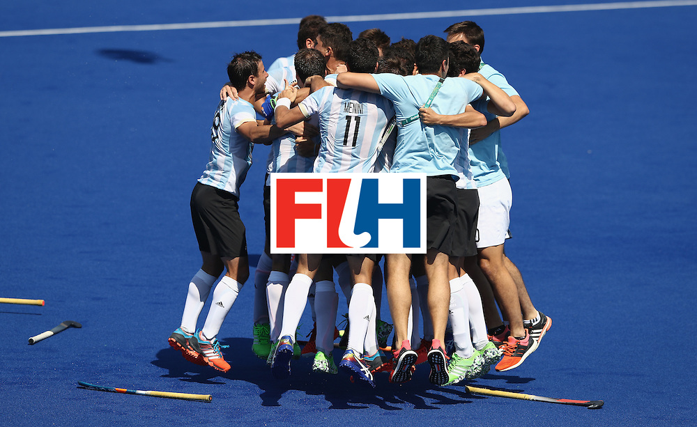 RIO DE JANEIRO, BRAZIL - AUGUST 14:  Argentina celebrate after their 2-1 victory during the Men's hockey quarter final match between Spain and Argentina on Day 9 of the Rio 2016 Olympic Games at the Olympic Hockey Centre on August 14, 2016 in Rio de Janeiro, Brazil.  (Photo by David Rogers/Getty Images)