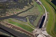 Nederland, Zeeland, Oosterschelde, 12-06-2009; Verdronken land van Zuid-Beveland, onderdeel van de Oosterschelde. Links van de dijk de vroegere haventje van Rattekaai, met vergane steigers, rijksmonument. De zeedijk wordt verbeterd en voorzien van nieuwe bekleding. Swart collectie, luchtfoto (25 procent toeslag); Swart Collection, aerial photo (additional fee required).foto Siebe Swart / photo Siebe Swart