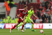 Middlesbrough FC midfielder Gaston Ramirez and Brighton central midfielder, Dale Stephens (6) during the Sky Bet Championship match between Middlesbrough and Brighton and Hove Albion at the Riverside Stadium, Middlesbrough, England on 7 May 2016.