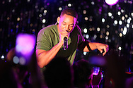 CAP D'ANTIBES, FRANCE - JUNE 21:  Will Smith joins Chris Martin of Coldplay on stage at a dinner party hosted by iHeartmedia and Medialink featuring a special performance by Chris Martin during the Cannes Lions Festival of Creativity at Hotel du Cap-Eden-Rock on June 21, 2016 in Antibes, France.  (Photo by Tony Barson/Getty Images for iHeartMedia)