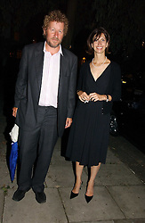 Writer SEBASTIAN FAULKS and his wife VERONICA at a party to celebrate the publication of Notting Hell by Rachel Johnson held in the gardens of 1 Rosmead Road, London W11 on 4th September 2006.<br />