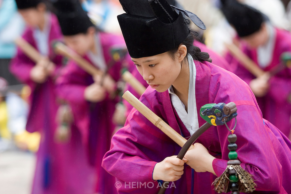 Jongmyo Jerye, a ritual service for Royal ancestors, performed on the first Sunday of May each year. Jongmyo (designated as a World Cultural Heritage by UNESCO in 1995) is a Confucian shrine where the ancestral tablets of kings and queens of the Joseon Dynasty are enshrined. Young ladies performing a dance ritual.