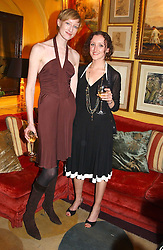 Left to right,JADE PARFITT and her sister AMY PARFITT at a private dinner and presentation of Issa's Autumn-Winter 2005-2006 collection held at Annabel's, 44 Berkeley Square, London on 15th March 2005.<br />