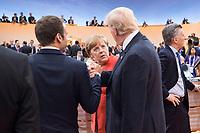 07 JUL 2017, HAMBURG/GERMANY:<br /> Emmanuel Macron (L), Praesident Frankreich, Angela Merkel (M), CDU, Bundeskanzlerin, und Donald Trump (R), Praesident Vereinigte Staatsn von America, USA, im Gesprech, vor Beginn der 1. Arbeitssitzung, G20 Gipfel, Messe<br /> IMAGE: 20170707-01-026<br /> KEYWORDS: G20 Summit, Deutschland, Gespr&auml;ch, Handshake, Armdruecken, Armdr&uuml;cken, Hand, Haende, H&auml;nde, sch&uuml;tteln, schuetteln