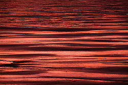 © Licensed to London News Pictures.11/10/15<br /> Saltburn, UK. <br /> <br /> A fiery Autumn sunrise is reflected on wet sand on the beach at Saltburn by the Sea in Cleveland.<br /> <br /> Photo credit : Ian Forsyth/LNP