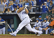 Oct 9, 2015; Kansas City, MO, USA; Kansas City Royals designated hitter Kendrys Morales (25) hits a home run against the Houston Astros in game five of the ALDS at Kauffman Stadium. Mandatory Credit: Peter G. Aiken-USA TODAY Sports