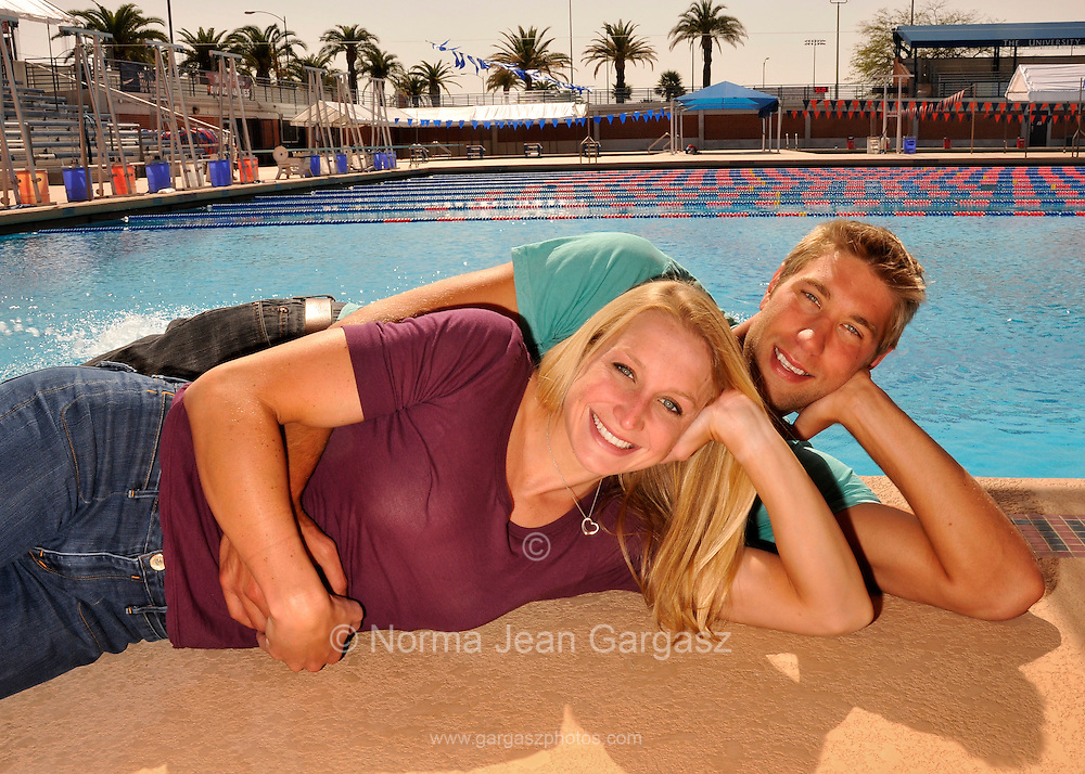 """Matt Grevers, (right), and Annie Chandler are U.S. National Swim Team members who train together at the University of Arizona.  They got engaged on February 11 after a race at a swim meet in Columbia, Missouri.  Matt won first place in backstroke.  When Annie presented the awards, Matt got down on one knee on the podium and proposed.  Annie said, """"Yes."""""""