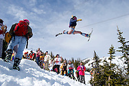 PRICE CHAMBERS / NEWS&amp;GUIDE<br /> With a throng of revelers cheering him on, Ben Skelly hits the kicker above the Thunder Bumps at Jackson Hole Mountain Resort on Monday's annual celebration of Gaper Day.