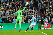 Kepa Arrizabalaga (1) of Chelsea punches the ball away from Bernardo Silva (20) of Manchester City during the Carabao Cup Final match between Chelsea and Manchester City at Wembley Stadium, London, England on 24 February 2019.