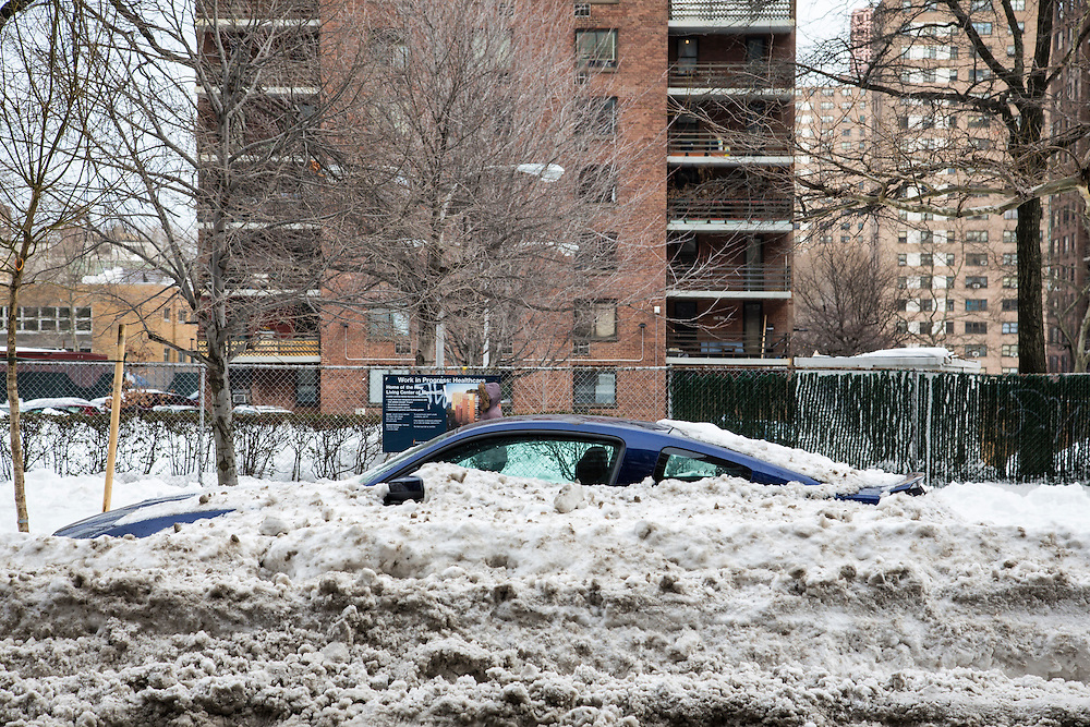 A blue car, parked on the street outside a tower block of flats in Upper West Side, New York City,  New York, United States of America, covered in snow after the snowstorm in January 2016. The snowstorm brought more than 2 feet of snow in many areas, which broke many records.  (photo by Andrew Aitchison / In pictures via Getty Images)
