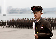 ARMY TIME IN NORTH KOREA<br /> The very first order you receive from your guide when arriving in North Korea is NOT to take pictures of the soldiers. This is difficult as you see them everywhere at any occasion, so the temptation is high !<br /> <br /> Their uniforms seem to come from the 50s. and it is ! The Korean People's Army was created in 1948 in the Soviet occupation zone of Korea. So, the uniforms were copied from the USSR.<br /> <br /> You will see soldiers in the morning, in the main squares of Pyongyang, when  soldiers rehearse their parade for hours. They do not like to have witnesses as everything is not -yet- perfect but have no choice as they need huge spaces to train. Each soldier has a number to allow the officers to tell who is good and who is bad.<br /> <br /> You will see them in the countryside when you leave the big towns. <br /> Many soldiers are used as a labor force to compensate for the ineffective North Korean economy, so the army is not only about military organization.<br /> During my 6 trips in North Korea, i saw so many soldiers collecting wood and carrying it along the roads. Wood for heating and for eating. North Korean soldiers can be seen working in fields, farms, or on construction sites in many places, far from military exercises.<br /> <br /> You will see them in pictures when visiting the school or the universities : at the entrance, some letters are displayed on the walls, showing the picture of a young man in uniform above a short text. They are letters from former school students that joined the army and who tell about their lifes as  soldiers. Of course everything is fantastic and they write they are so proud to serve their nation.<br /> <br /> In North Korea, most of the soldiers serve in military for 10 years, female soldiers serve  for seven years. Some high level students only serve few years to work quickly and to be more efficient than when they carry wood…<br /> Once in the army, the contacts with the families is very complicated as the whole country is not covered with mobile phones. A lette