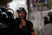 Egyptian riot police help a wounded colleague during continuing January 26, 2011 demonstrations in downtown Cairo, Egypt. A series of unprecedented demonstrations have broken out across Egypt for the past two days, inspired by the revolution in Tunisia, and intended to spark a similar movement in Egypt. (Photo by Scott Nelson)