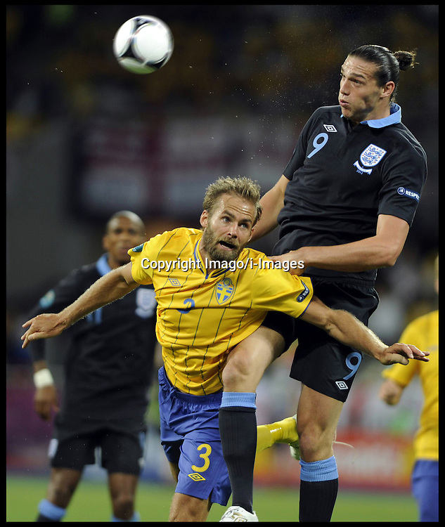 Andy Carroll and Sweden's Olof Mellberg  during England v Sweden in the Group D Sweden v England match, June 15, 2012, in Kiev during the UEFA Euro 2012. Photo by Imago/i-Images