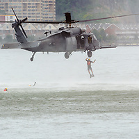A United States Air Force Search & Rescue Team  performs a water rescue demonstration in the HUdson River next near the USS Intrepid during Air Force Week 2012 in New York City.