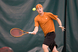 Texas Longhorns Damico Kellen hits a forehand.  The #1 ranked Virginia Cavaliers men's tennis team defeated the #5 ranked Texas Longhorns 5-2 at the Boyd Tinsley Courts at the Boar's Head Inn and Resort in Charlottesville, VA on February 29, 2008.
