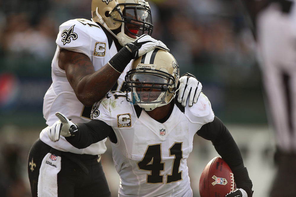 New Orleans Saints safety Roman Harper (41) celebrates with safety Malcolm Jenkins (27) during an NFL game on Sunday, Nov. 18, 2012 at the Oakland Coliseum in Oakland, Ca. (AP Photo/Jed Jacobsohn)