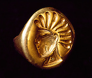 The Golden Warrior wore a gold seal ring onf the sun god mitra on the middle finger of his right hand.  On his fourth finger he wore a gold mirror or solar ring.  Both are cast, engraved and polished.  Museum of Archeology, Almaty, Kazakhstan