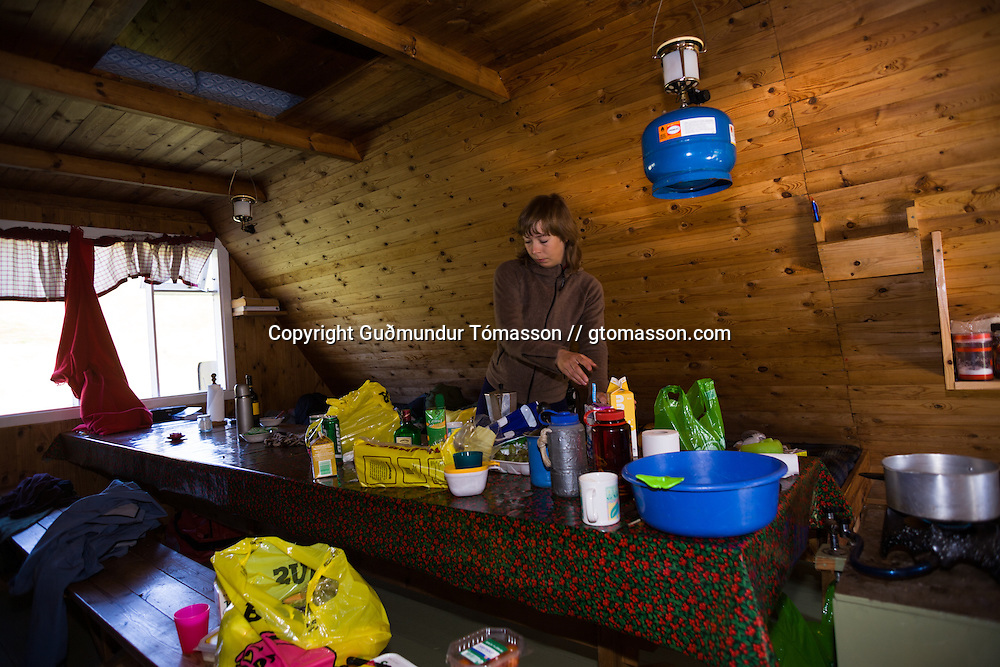 "Helga Björt Möller in the hut ""Heiðarhús"". Flateyjardalur, Iceland."
