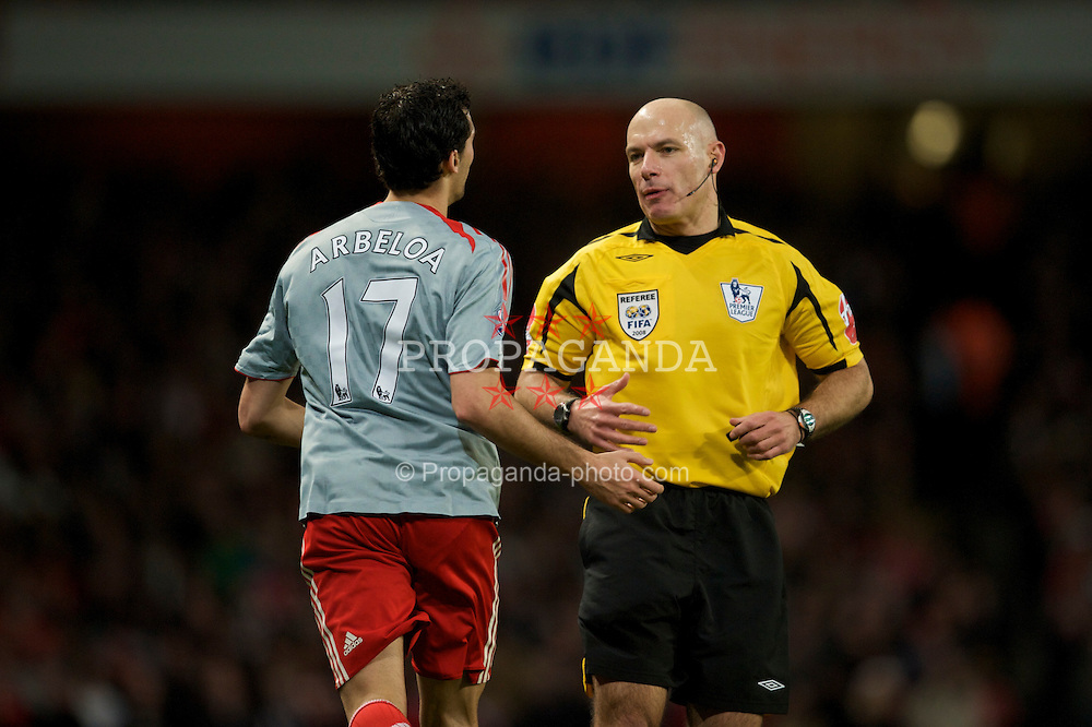 LONDON, ENGLAND - Sunday, December 21, 2008: Liverpool's Alvaro Arbeloa and referee Howard Webb during the Premiership match against Arsenal at the Emirates Stadium. (Photo by David Rawcliffe/Propaganda)