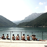 Young boys on Scutari lake.There are several arguments about the derivation of the name  &quot;Montenegro&quot;, one of these relates to dark and deep forests  that once covered the Dinaric Alps, as it was possible to see them from the sea. <br /> Mostly mountainous with 672180 habitants on an area of 13812 Km&sup2;, with a population density of  48 habitants/Km&sup2;. <br /> It borders with Bosnia, Serbia, Croatia, Kosovo and Albania but  Montenegro has always been alien to the bloody political events that characterized Eastern Europe in recent decades. <br /> From 3 June 2006, breaking away from Serbia, Montenegro became an independent state. <br /> In the balance between economy devoted to sheep farming and a shy tourist, mostly coming from Bosnia and Herzegovina, Montenegro looks to Europe with a largely unspoiled natural beauty. <br /> Several cities in Montenegro, as well as the park Durmitor, considered World Heritage by UNESCO but not yet officially because Montenegro has yet to ratify the World Heritage Convention of UNESCO.