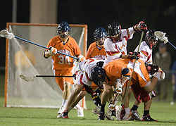 Virginia midfielder Mike Thompson (17) fights for a loose ball.  The #3 ranked Virginia Cavaliers defeated the #8 ranked Maryland Terrapins 11-8 in the semi finals of the Men's 2008 Atlantic Coast Conference tournament at the University of Virginia's Klockner Stadium in Charlottesville, VA on April 25, 2008.