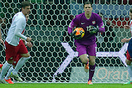 (C) Poland's goalkeeper Wojciech Szczesny controls the ball during international friendly soccer match between Poland and Scotland at National Stadium in Warsaw on March 5, 2014.<br /> <br /> Poland, Warsaw, March 5, 2014<br /> <br /> Picture also available in RAW (NEF) or TIFF format on special request.<br /> <br /> For editorial use only. Any commercial or promotional use requires permission.<br /> <br /> Mandatory credit:<br /> Photo by © Adam Nurkiewicz / Mediasport